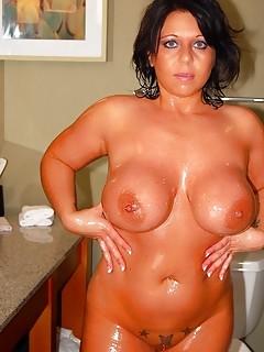 Voluptuous MILF Oils Her Big Tits and Big Ass